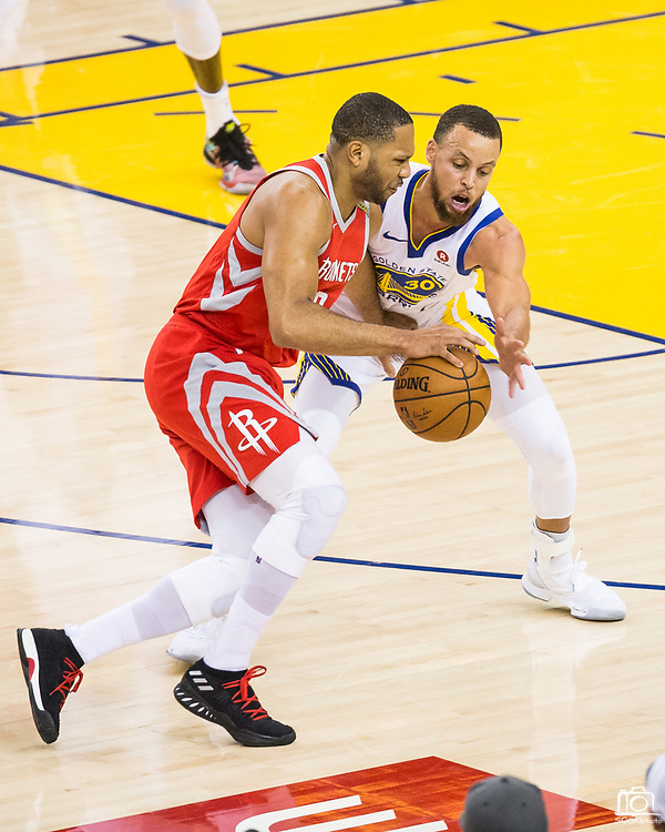 Golden State Warriors guard Stephen Curry (30) defends Houston Rockets guard Eric Gordon (10) during Game 6 of the Western Conference Finals at Oracle Arena in Oakland, Calif., on May 26, 2018. (Stan Olszewski/Special to S.F. Examiner)