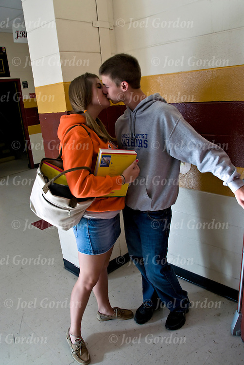 High School couple in hallway about to kiss before school bell