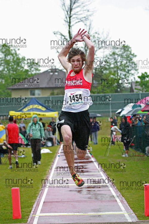 Joe Wilson of Penetanguishene SS - Penetang competes in the junior boys long jump at the 2013 OFSAA Track and Field Championship in Oshawa Ontario, Thursday,  June 6, 2013.<br /> Mundo Sport Images / Sean Burges