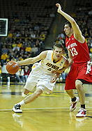 January 04 2010: Iowa Hawkeyes guard Matt Gatens (5) drives around Ohio State Buckeyes guard Jon Diebler (33) during the first half of an NCAA college basketball game at Carver-Hawkeye Arena in Iowa City, Iowa on January 04, 2010. Ohio State defeated Iowa 73-68.
