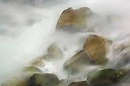 Water crashing on rocks at the base of Feather Falls (410 ft.) Feather Falls Scenic Area, Plumas National Forest, Butte County, California