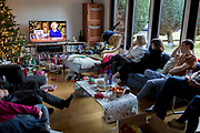 A British family watch the Queen's speech to the nation on Christmas Day, a tradition started in 1932 and which she first broadcast on television in 1957, on 25th December 2019, in Bristol, England.