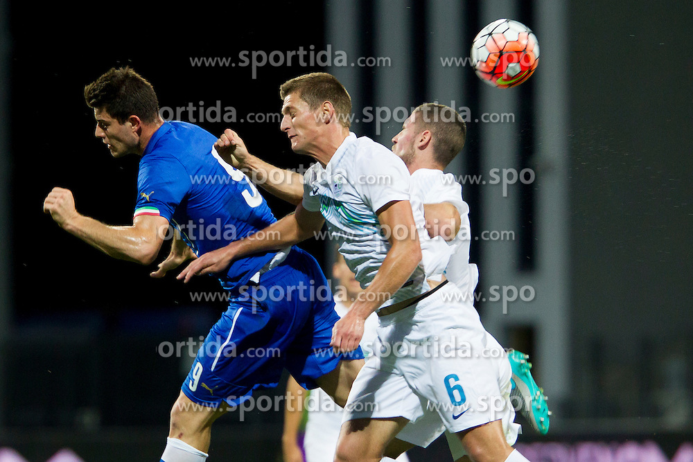 Cerri of Italy and Leo Ejup of Slovenia during football match between U21 National Teams of Slovenia and Italy in 4th Round of UEFA 2017 European Under-21 Championship Qualification on October 8, 2015 in stadium Bonifika, Koper / Capodistria, Slovenia. Photo by Urban Urbanc / Sportida