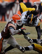 MORNING JOURNAL/DAVID RICHARD.Pittsbugh's Tony Polamalu helps bring down Reuben Droughns of Cleveland yesterday in the fourth quarter.