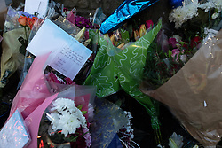 © Licensed to London News Pictures . 29/12/2018 . Wigan , UK . Tributes and flowers left at the scene where police have taped off a stretch of Bickershaw Lane in Abram . GMP report they have arrested two people on suspicion of attempted murder and for conspiracy to commit attempted murder , respectively , after a 21-year-old man , identified locally as Billy Livesley , sustained life-threatening injuries yesterday evening (Friday 28th December 2018) . Photo credit : Joel Goodman/LNP