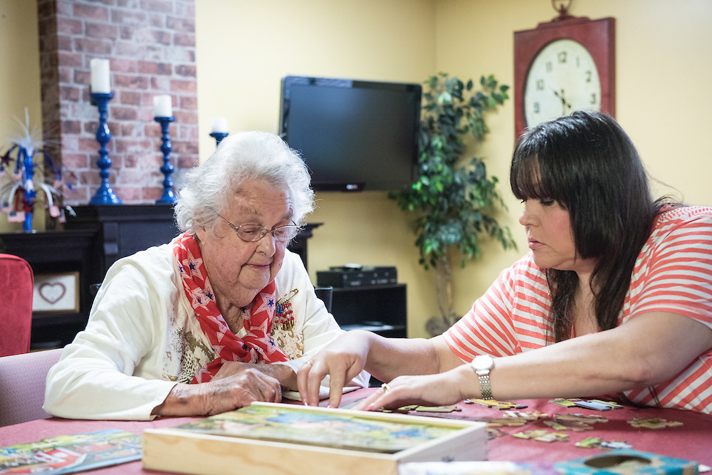 Patients Ruth Klingenfus and Rhonda Carmen work a puzzle together Wednesday, May 27, 2015 at Baptist Health in LaGrange, Ky. (Photo by Brian Bohannon/Videobred for Baptist Health)