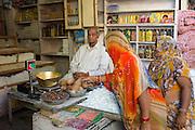 Indian women shopping for food at Tambaku Bazar in Jodhpur Old Town, Rajasthan, Northern India