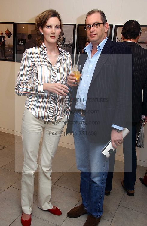 MR WILLE STIRLING and ANNABEL WATSON at an exhibition of photographs entitled 'Protect The Human' by photographers Jake Gavin and Sean Gleason commissioned by Amnesty Internationlal and held at The Hospital, 24 Endell Street, London WC2 on 31st May 2006.<br />