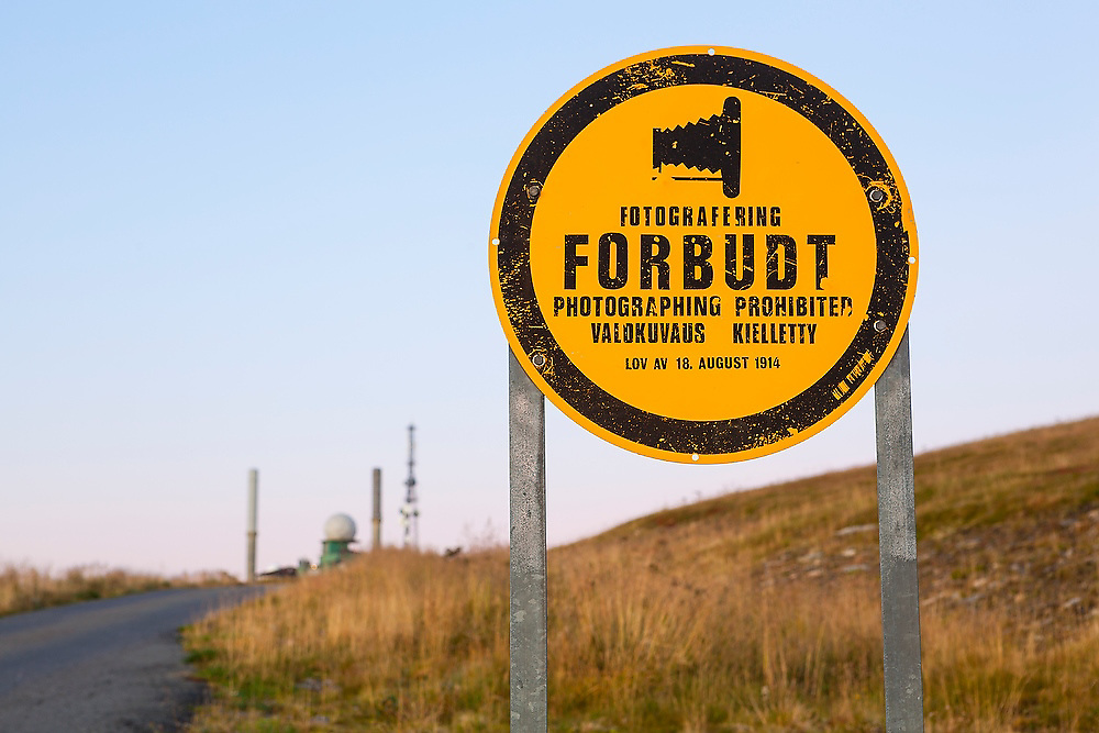 An old sign prohibiting photography at the North Atlantic Treaty Organization (NATO) naval military radar on Vaeroy Island, Lofoten Islands, Norway.