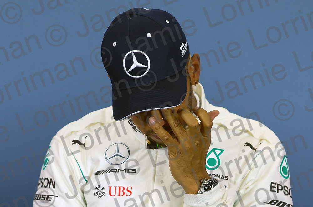 The 2018 Formula 1 F1 Rolex British grand prix, Silverstone, England. Saturday 7th July 2018.<br /> <br /> Pictured: Mercedes AMG Petronas driver Lewis Hamilton wipes tears from his eyes at the press conference after qualifying in pole position for tomorrow's British Grand Prix at Silverstone.<br /> <br /> Jamie Lorriman<br /> mail@jamielorriman.co.uk<br /> www.jamielorriman.co.uk<br /> 07718 900288