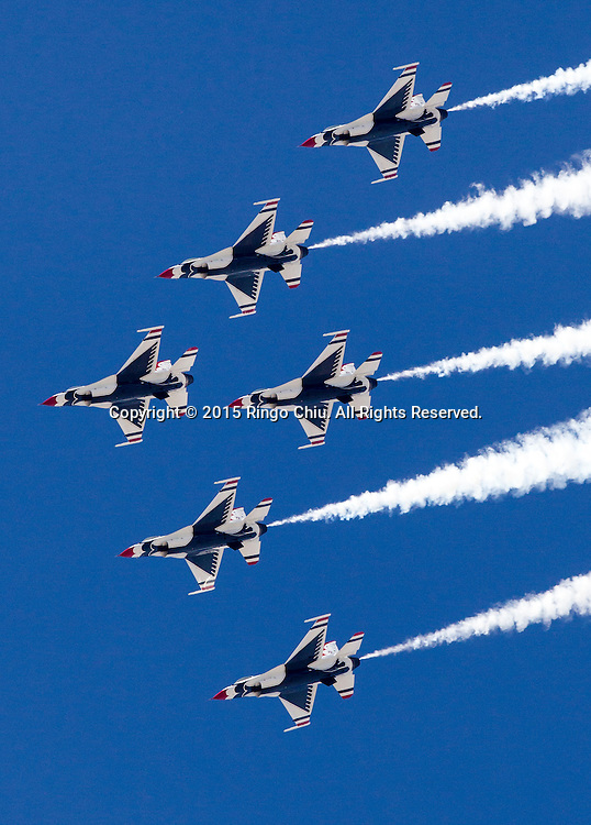 F-16 Fighting Falcons of the U.S. Air Force Thunderbirds perform during Los Angeles County Air Show in Lancaster, California on March 21, 2015. (Photo by Ringo Chiu/PHOTOFORMULA.com)