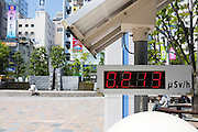 A geiger counter in the city square outside the train station in Fukushima City, Japan