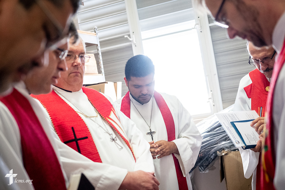The Rev. Gustavo Maita (center), prays with fellow pastors (L-R) the Rev. Angel Ramos, pastor of Faith Lutheran Church, Clewiston, Fla., the Rev. Ted Krey, regional director for the Latin America and the Caribbean region of the LCMS, the Rev. David Becker, pastor of St. John Lutheran Church, Aitkin, Minn., the Rev. Richard Schuller, career missionary to Puerto Rico, and the Rev. Charles St. Onge, area director for the Caribbean, before worship at Iglesia Luterana Principe de Paz (Prince of Peace Lutheran Church), Mayagüez, Puerto Rico, on Sunday, April 15, 2018. LCMS Communications/Erik M. Lunsford