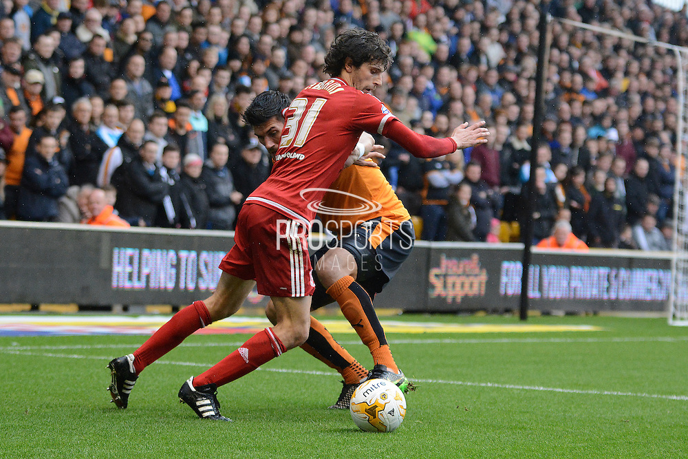 Middlesbrough striker Diego Fabbrini skips past Wolverhampton Wanderers defender Danny Batth during the Sky Bet Championship match between Wolverhampton Wanderers and Middlesbrough at Molineux, Wolverhampton, England on 24 October 2015. Photo by Alan Franklin.