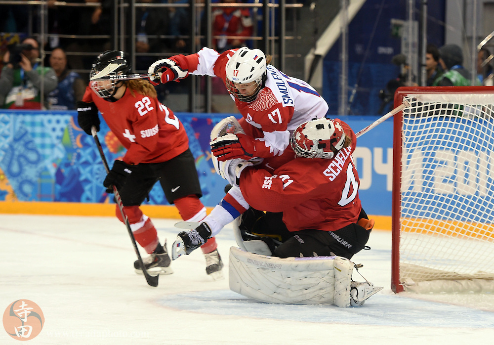 Feb 15, 2014; Sochi, RUSSIA; Switzerland goalkeeper Florence Schelling (41) collides with Russia forward Yekaterina Smolentseva (17) in a women's quarterfinals ice hockey game during the Sochi 2014 Olympic Winter Games at Shayba Arena.