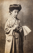 Geisha woman in kimono dress, Japanese postcard 1900.