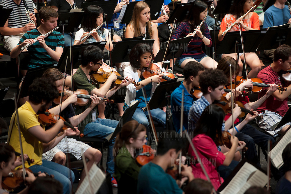 July 9, 2013 - Purchase, NY : The National Youth Orchestra of the United States of America rehearses with conductor Valery Gergiev (not pictured) at SUNY Purchase's Performing Arts Center in Westchester on Tuesday afternoon. The Orchestra, a new project of Carnegie Hall's Weill Music Institute, is comprised of musicians aged 16-19, hand-picked from across the country. The program -- and orchestra -- will kick off its inaugural season with a performance at SUNY Purchase on Thursday evening, and then head off to perform in Washington DC,  Moscow, St. Petersburg, and London. CREDIT: Karsten Moran for The New York Times