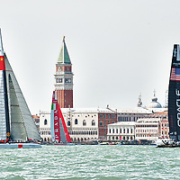America's Cup  World Series  in Venice second day of races sees Luna Rossa dominate the day with three victories. On the background St Mark's Square and the Palazzo Ducale