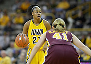 February 10 2011: Iowa Hawkeyes guard Kachine Alexander (21) with the ball as Minnesota Golden Gophers guard Brianna Mastey (41) defends during the first half of an NCAA women's college basketball game at Carver-Hawkeye Arena in Iowa City, Iowa on February 10, 2011. Iowa defeated Minnesota 64-62.