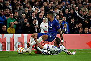 Chelsea FC defender Emerson Palmieri (33) is fouled by Mol Vidi defender Fiola Attila (5) during the Europa League match between Chelsea and MOL Vidi at Stamford Bridge, London, England on 4 October 2018.
