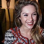NLD/Amsterdam/20131113 - VIP avond bij Isabel Marant pour H&M, Lauren Verster met button van partner Jort Kelder