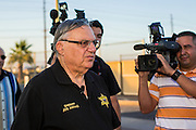 "23 JUNE 2012 - PHOENIX, AZ:  Maricopa County Sheriff JOE ARPAIO talks to reporters during a press conference on front of his jails Saturday afternoon. About 2,000 members of the Unitarian Universalist Church, in Phoenix for their national convention, picketed the entrances to the Maricopa County Jail and ""Tent City"" Saturday night. They were opposed to the treatment of prisoners in the jail, many of whom are not convicted and are awaiting trial, and Maricopa County Sheriff Joe Arpaio's stand on illegal immigration. The protesters carried candles and sang hymns.      PHOTO BY JACK KURTZ"