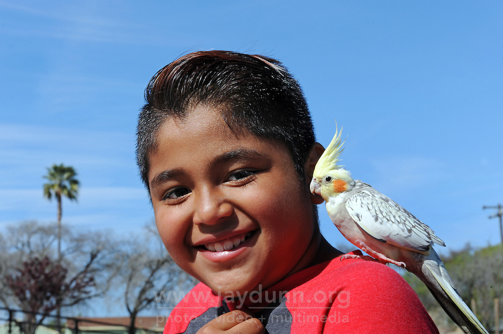 Ricardo Arellano, 9, and Pikachu the cockatoo enjoying a beautiful afternoon at Closter Park in Salinas.