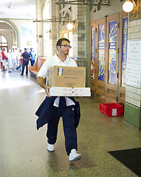 BALTIMORE, MD - Saturday, July 28, 2012: A member of Tottenham Hotspur's staff carries pizza's to the train as the team head for New York after a pre-season friendly match against Liverpool at the M&T Bank Stadium. (Pic by David Rawcliffe/Propaganda)