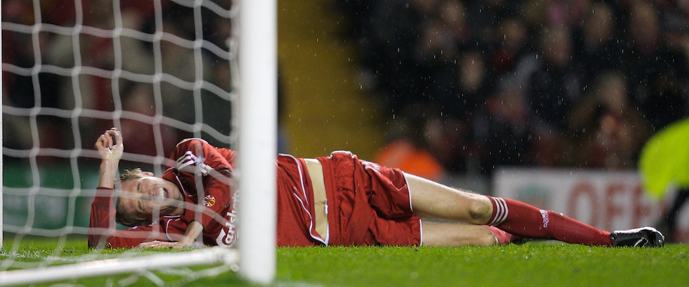 LIVERPOOL, ENGLAND - Tuesday, January 15, 2008: Liverpool's Peter Crouch lies injured after crashing into the goalpost against Luton Town during the FA Cup 3rd Round Replay at Anfield. (Photo by David Rawcliffe/Propaganda)