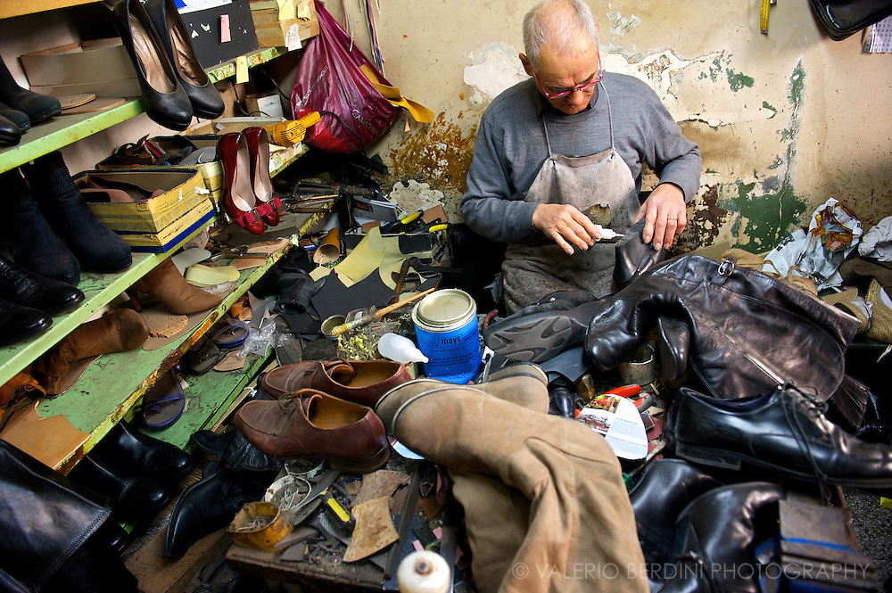 One of the last cobblers in his workshop. The low production costs in the emerging economies makes artisanal repairs unsustainable.