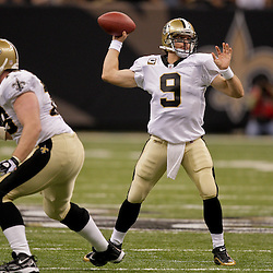 2009 October 18: New Orleans Saints quarterback Drew Brees (9) throws a pass during the first half against the New York Giants at the Louisiana Superdome in New Orleans, Louisiana.