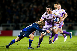 Dave Dennis of Exeter Chiefs takes on Faf De Klerk of Sale Sharks - Mandatory by-line: Robbie Stephenson/JMP - 08/12/2019 - RUGBY - AJ Bell Stadium - Manchester, England - Sale Sharks v Exeter Chiefs - Heineken Champions Cup