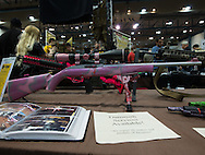 December 16th, Custom painted 22 long riffle (Mossberg 709 Plingster ) on display at a<br /> gun show at the Pontchartrain Center in Kenner Louisiana held by Great Southern Gun and Knife Shows L.L. C. . John Gautheir owner of On Target, painted the riffle pink for his daughter when she was eight years old. Gun sales have increased since the school shooting massacre in Sandy Hook Connecticut.