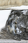 Waterfall from a melting glacier in Spitsbergen, Svalbard, Norway