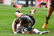 Wasps winger Marcus Watson (15) dives for the line during the Gallagher Premiership Rugby match between Wasps and London Irish at the Ricoh Arena, Coventry, England on 20 October 2019.