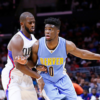 02 October 2015: Denver Nuggets guard Emmanuel Mudiay (0) drives past Los Angeles Clippers guard Chris Paul (3) during the Los Angeles Clippers 103-96 victory over the Denver Nuggets, in a preseason game, at the Staples Center, Los Angeles, California, USA.