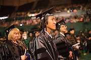 Yearry Pansi Setianto is recognized for earning his PhD in Mass Communications during graduate commencement. Photo by Ben Siegel