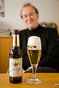 "Joachim Rösch, a brewmaster at the Ganter Brewery in Freiburg im Breisgau, Germany. (Joachim Rösch is featured in the book What I Eat: Around the World in 80  Diets.)  The caloric value of his day's worth of food in March was 2700 kcals. He is 44 years of age; 6 feet, 2 inches tall; and 207 pounds. Joachim's job requires him to taste beer a number of times during the week, and unlike in wine tasting, he can't just taste then spit it out: ""Once you've got the bitter on the back of your tongue, you automatically get the swallow reflex, so down the chute you go,"" he says. MODEL RELEASED."