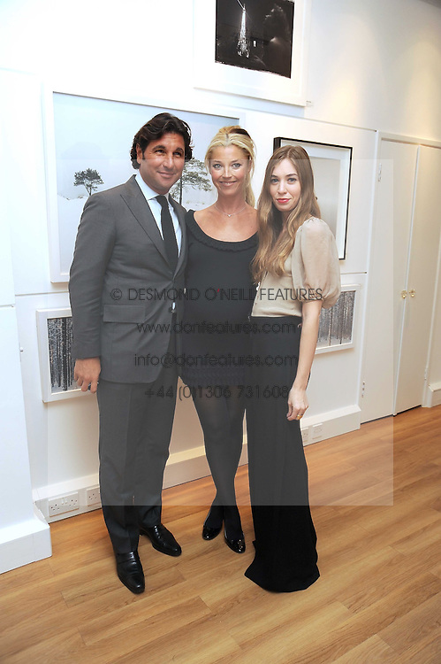 Left to right, GEORGE VERONI, his wife TAMARA BECKWITH and her daughter ANOUSKA BECKWITH at a private view of 'Most Wanted' an exhibition of photographs held at The Little Black Gallery, Park Walk, London on 27th November 2008.