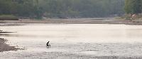 Man in a river, Bardiya National Park, Nepal