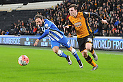 Hull City defender Andrew Robertson (26)  and Brighton defender, full back, Inigo Calderon (14) fight for the ball during the The FA Cup match between Hull City and Brighton and Hove Albion at the KC Stadium, Kingston upon Hull, England on 9 January 2016. Photo by Ian Lyall.