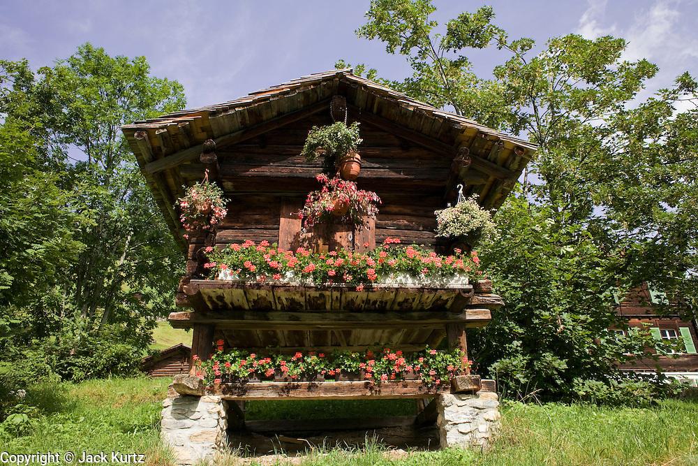 02 AUGUST 2007 -- INTERLAKEN, BERN, SWITZERLAND: Flowers decorate the front of a cabin in Murren, a small village in the Swiss Alps in the canton of Bern, Switzerland. PHOTO BY JACK KURTZ