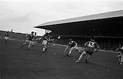 02/09/1962<br /> 09/02/1962<br /> 2 September 1962<br /> All-Ireland Minor Final: Tipperary v Kilkenny at Croke Park, Dublin. <br /> P. Delaney (left) shoots towards the Kilkenny goal. D. Moloney (Tipperary 13) also is in the picture.