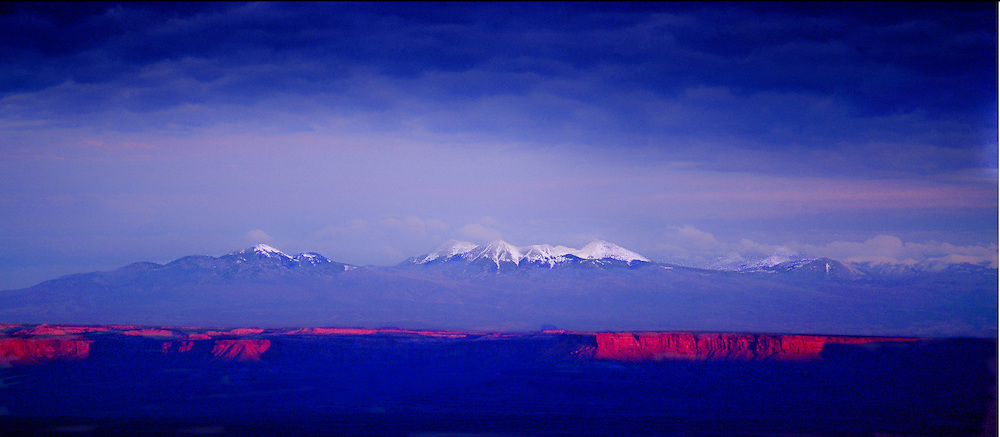 Snow capped La Sal Mountains from Maze District, Canyonlands National Park, red cliffs