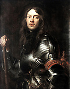 Portrait of a man in Armour Wearing a Red Armband. Oil on canvas. Anthony van Dyck (1599-1641) Flemish Baroque artist.