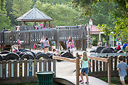 Families on the playground in Abita Springs Park before fireworks on July 2, 2017
