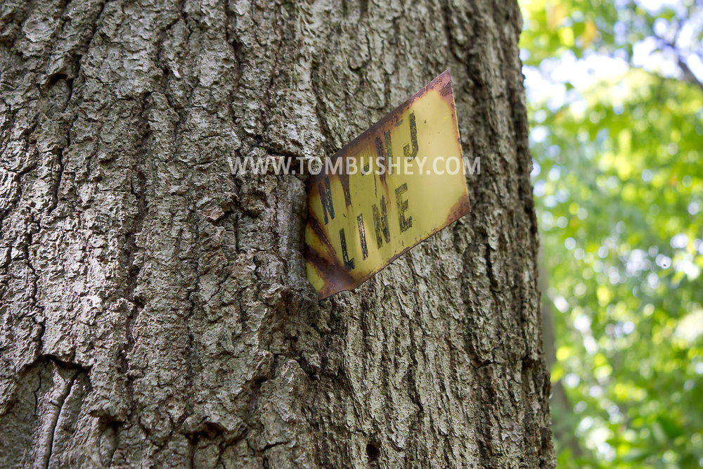 Warwick, New York - A sign marking the New York-New Jersey border seen during a hike at Fuller Mountain Preserve as part of the 2012 Hudson River Valley Ramble on Sept. 15, 2012. The preserve is owned and managed by the Orange County Land Trust.
