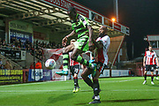 Forest Green Rovers Isaiah Osbourne(34) controls the ball under pressure from Cheltenham Town's Nigel Atangana(6) during the EFL Trophy match between Cheltenham Town and Forest Green Rovers at Whaddon Road, Cheltenham, England on 3 October 2017. Photo by Shane Healey.