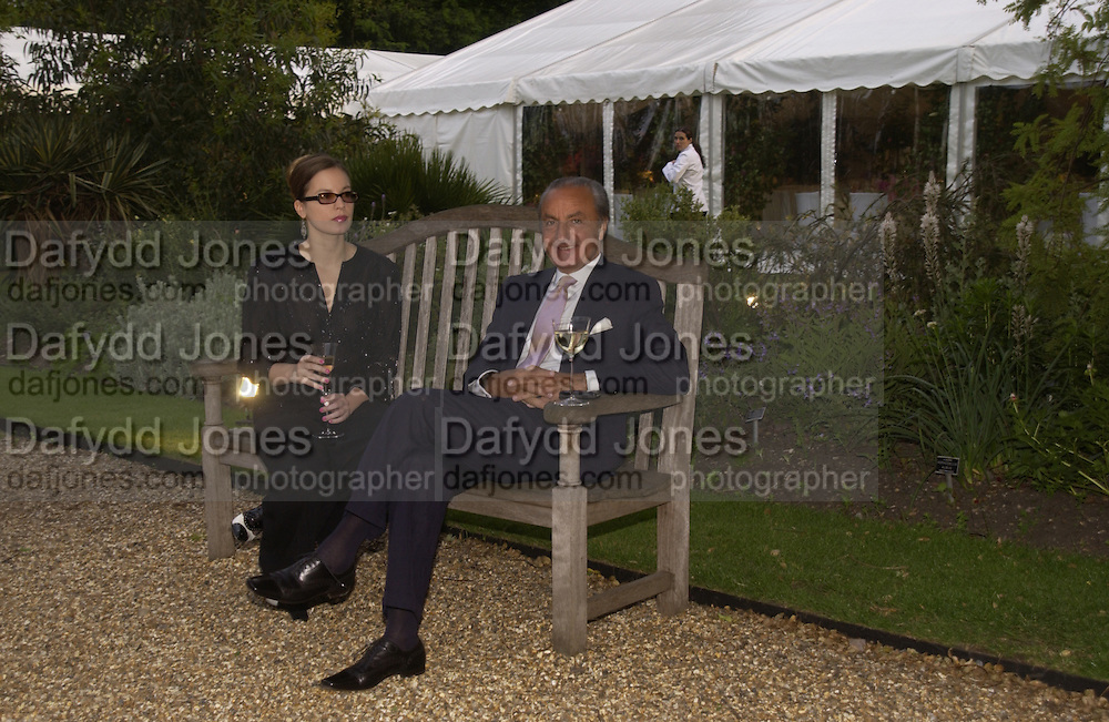 Mr. and Mrs. Samir Traboulsi, Cartier Flower show dinner, Chelsea Physic garden, 24 May 2004. ONE TIME USE ONLY - DO NOT ARCHIVE  © Copyright Photograph by Dafydd Jones 66 Stockwell Park Rd. London SW9 0DA Tel 020 7733 0108 www.dafjones.com