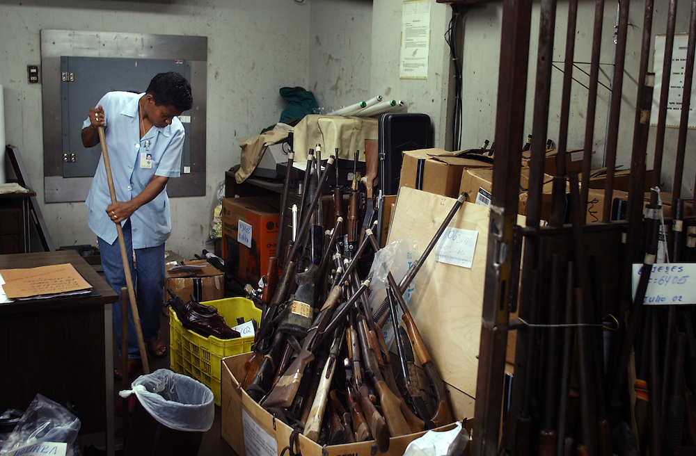 Inside the arms room at the Cuerpo de Investigaciones Cientificas, Penales y Criminales(CICPC) headquarters.  The CICPC is the national body which, among other things, is responsible for investigating murders.  In this room the CICPC stores all of the weapons that have been collected in the country for any reason. The weapons are kept here for 2 to 3 months before being moved to a military base. Commissioner Carlos Rodriguez of the CICPC said that they process 1000 arms every week.